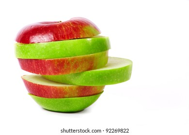 Close up apple segment red and green against white background