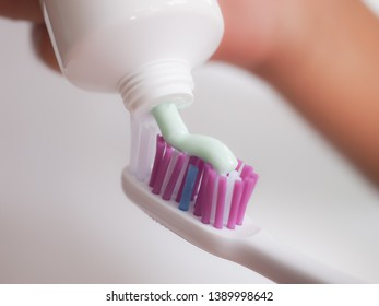 Close up applying toothpaste on toothbrush.Dental health care concept.