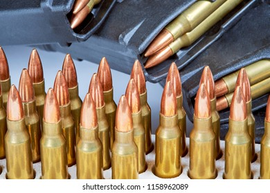 Close up of AR 15 full metal jacket ammunition with magazines