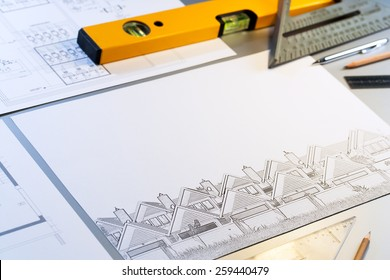 Close up of architectural design plans with measuring objects.