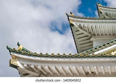 Close up architectural details of the three corner roofs structure at Osaka Castle with specific golden roof tile ornaments. Osaka Castle is one of the most famous historic landmarks in Japan.