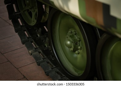 Close up of the army heavy armory vehicles tyres in green.