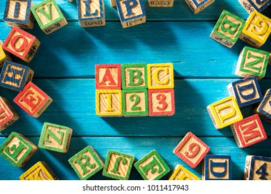 """Close up arrangement of """"ABC"""" alphabet on blue background. Preschool, education concept or other your content. Long shadow and vignette effect."""