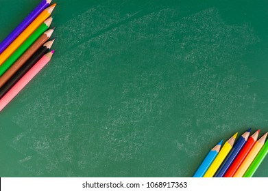 Close up arrangement of pencil color on chalk board. Preschool, education, back to school and copy-space concept or other your content.