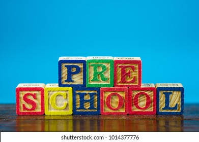 "Close up arrangement of ""Preschool"" alphabet on blue background. Preschool, education and copy-space concept or other your content."
