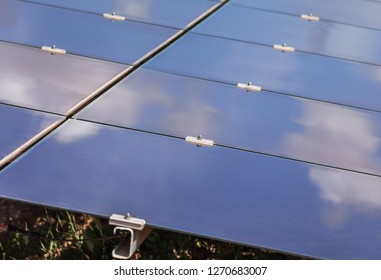 Close up array of  thin film solar cells or amorphous silicon solar cells or photovoltaics in solar power plant turn up skyward absorb the sunlight from the sun use light energy to generate electricit