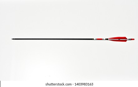 a close up of an arrow with a red end on a white background