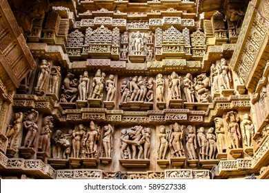 Close up of artful carved walls of Kandariya Mahadeva Temple, Khajuraho Group of Monuments, India