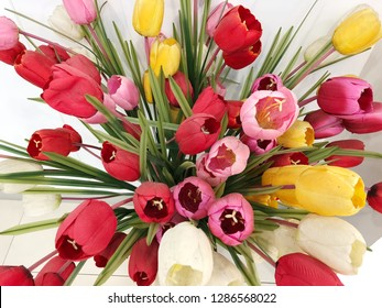 Close up of artificial flower bouquet on white background