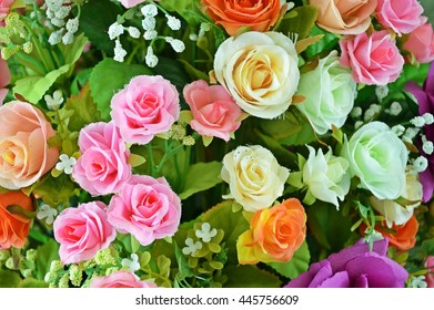 Close up Artificial flowers pots in garden, artificial orange, white, and pink roses bouquet close up from top view, roses flowers for wedding decoration