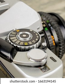 A close up of a asa iso dial on a vintage 35mm film analog camera