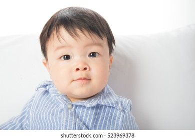 Close up asian baby face smiling 7 months old