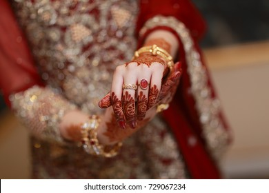 Close up of Asian bride hand at a wedding, concept of marriage/partnership/commitment