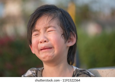 Close up of Asian child crying