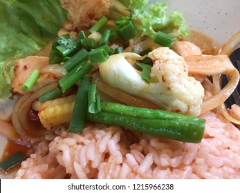 Close up of Asian fried rice nasi goreng with paprik, Thai food made of chicken and vegetables with tomato sauce.
