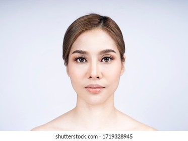 close up Asian girl beauty face aesthetic with filler Lip by syringe white background beauty and Surgery Lip fillers concept