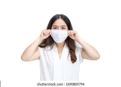 Close up of Asian girl wearing protective mask, with copy space, isolated on white background. Concept of Coronavirus COVID-19 reducing of risk of spreading the infection