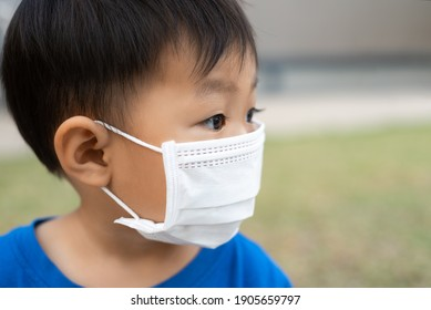 close up asian little boy wearing protect face mask
