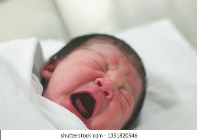 Close up of Asian newborn baby in a hospital