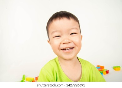 Close up Asian toddler boy smile with happy face