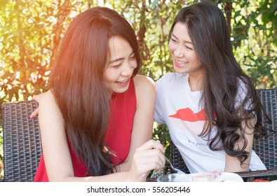 Close up Asian woman of best friends portrait lifestyle - young attractive smiling female talking with friend at outdoor coffee shop