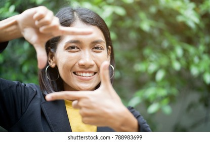 close up asian woman (businesswoman) showing hand as vision symbol for look forward to the future at outdoor park ,concept for good working