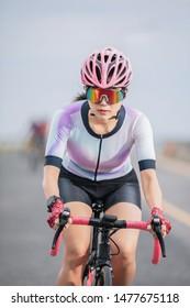 close up asian woman riding bicycle