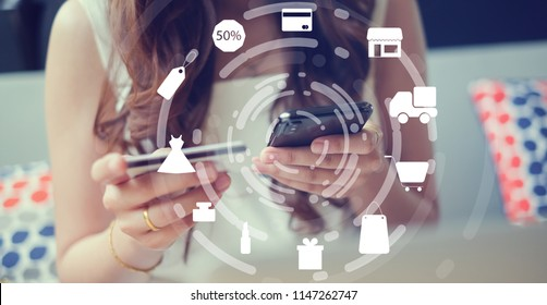 close up asian woman using smartphone mobile for make payment of credit card at home office with virtual interface of shopping online (b2b) technology concept