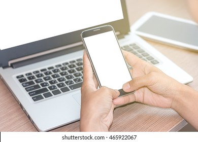 Close Up of Asian woman's hands using mobile phone and Coffee shop Laptop with blank copy space screen for your advertising text message or content, in the morning light.