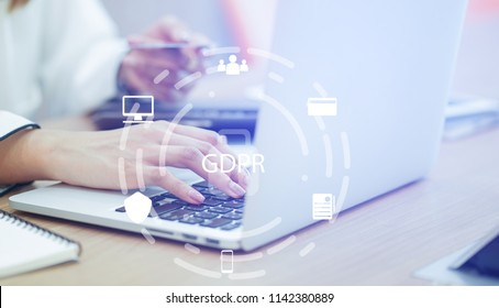 close up asian working woman use credit card for payment on laptop at home office with virtual interface of GDPR (General Data Protection Regulation ) , privacy personal data concept