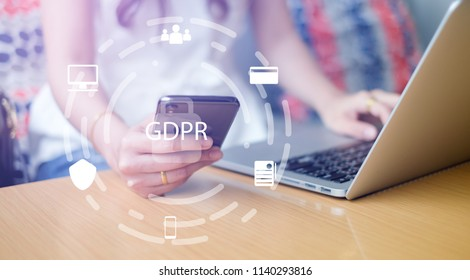 close up asian working woman using smartphone mobile and laptop at home office with virtual interface of GDPR (General Data Protection Regulation ) , privacy personal data concept