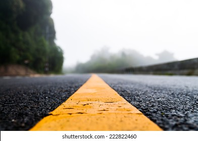 Close up of asphalt road with nature background, shallow focused