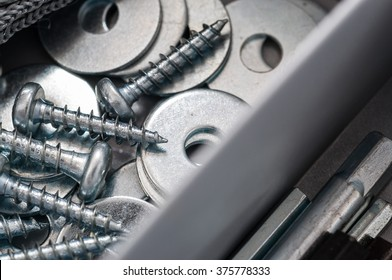 Close up of assorted steel screws and washers