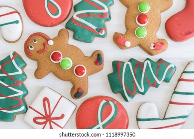 Close Up of Assortment of Christmas Gingerbread Cookies on White Wooden Background