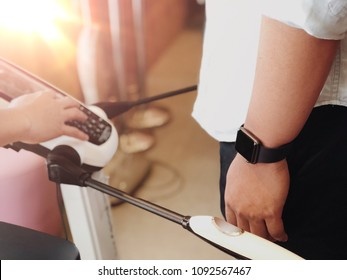 Close up of Athlete's Body Composition Analysis before Fitness Activity. Man with smart watch checking body with Body Composition Analysis machine. Health care, fitness and weight loss