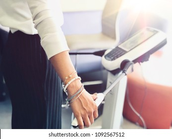 Close up of Athlete's Body Composition Analysis before Fitness Activity. Woman Checking body with Body Composition Analysis machine. Health care, fitness and weight loss
