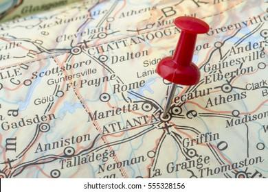 Close up of Atlanta map with red push pin.