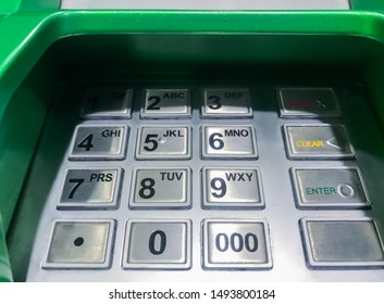 Close up of an ATM machine. Hand is going to press ATM EPP keyboard