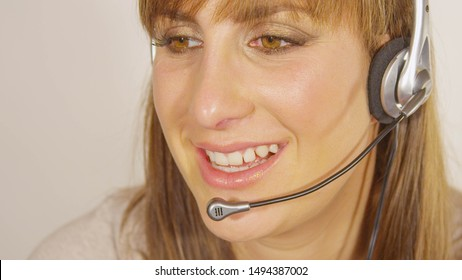 CLOSE UP Attentive tech support employee helping out client with network issues. Polite customer support agent talking to difficult clientele. Information centre worker responding to consumer inquiry