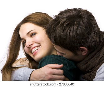 close up of attractive couple passionately in love hugging and smiling