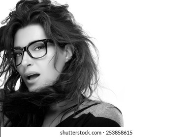 Close up attractive model woman face with casual hairstyle, wearing fashion eyeglasses while looking at camera. Cool trendy eyewear portrait. Monochrome isolated on white with Copy Space for Text