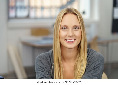 Close up Attractive Office Woman with Long Blond Hair, Looking at the Camera with Toothy Smile.
