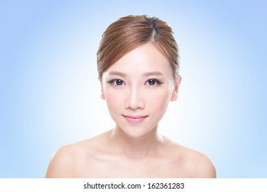 close up of attractive woman face with blue background, asian beauty