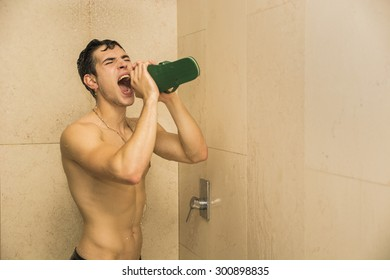 Close up Attractive Young Bare Muscular Young Man Taking Shower Sticking Out Tongue and Uncovering Bottocks
