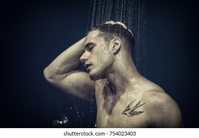 Close up Attractive Young Bare Muscular Young Man Taking Shower, with Eyes Closed