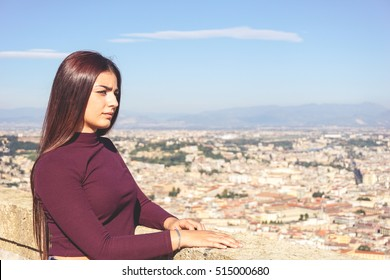 Close up of attractive young girl with long hair looking the beautiful view