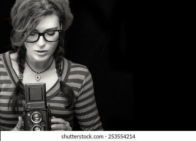 e585ef206ae Close up Attractive Young Woman in Red Trendy Outfit Capturing Photo Using  Vintage Camera. Monochrome