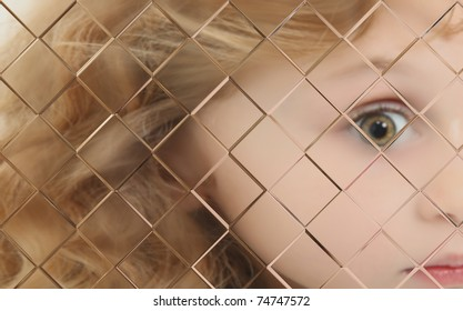 Close Up Of Autistic Child Behind Pane Of Glass