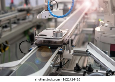 Close up of an automated car brings product to assembly station of smart factory prototype. Industry 4.0 smart manufacturing concept using artificial intelligence and Internet of Things in production.
