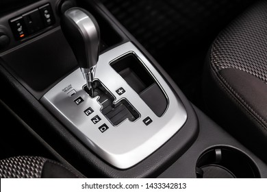 Close up of the automatic gearbox lever, blackinterior car; Automatic transmission gearshift stick;